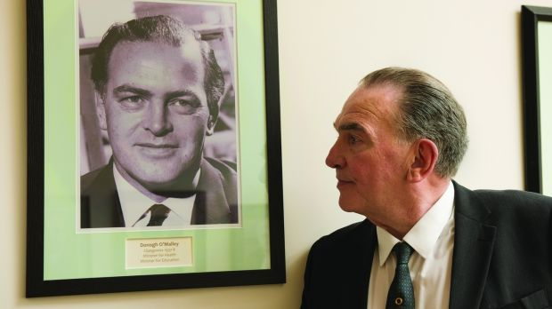 Actor Daragh O'Malley looking at picture of his father, former minister for education Donogh O'Malley.