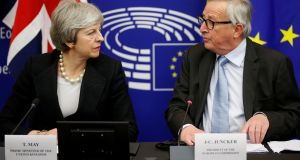 British prime minister Theresa May and European Commission President Jean-Claude Juncker look at each other during a news conference in Strasbourg earlier this month. Photograph: Vincent Kessler / Reuters