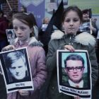 Two children hold pictures of Bloody Sunday victims James Wray and William McKinney during a vigil in Belfast on March 14th. Photograph: Niall Carson/PA Wire