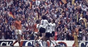 Gerd Muller (hidden) is surrounded by his team-mates after scoring the winning goal for West Germany against the Netherlands during the 1974  World Cup final at the Olympic Stadium in Munich. Photograph:  Paul Popper/Popperfoto/Getty Images