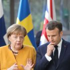 German chancellor Angela Merkel and French  president Emmanuel Macron in Brussels at the end of the EU summit focused on Brexit. Photograph: Ludovic Marin/AFP/Getty Images