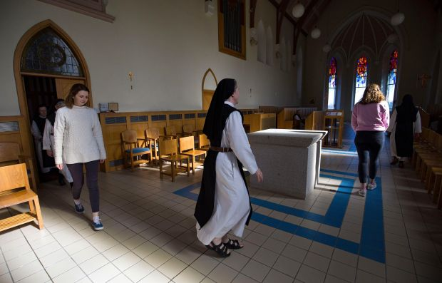 Call to prayer: Emma Brady, Sr Sarah and Grace McCann, a graduate of All Hallows College in Dublin, at Glencairn Abbey. Photograph: Valerie O'Sullivan