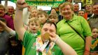 Special Olympian Mark Saddler shows off his bowling medal as he celebrates with his family after arriving home. Photograph: Nick Bradshaw/The Irish Times