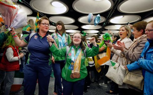Eimear Gannon (centre) arrives at Dublin airport with her medals and the rest of the Irish Special Olympics team. Team Ireland won 86 medals across 12 sports at the Abu Dhabi games. Photograph: Nick Bradshaw/The Irish Times