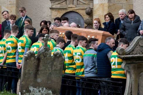 Members of the Edendork St Malachy's Gaelic Athletic Club give a guard of honour at the funeral of Connor Currie at St Malachy's Church, Edendork, Co Tyrone. Connor died after a crush at a disco at the Greenvale Hotel in Cookstown, Co Tyrone, on St Patrick's Day. Photograph: Liam McBurney/PA Wire