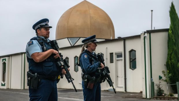 Armed police stand guard at Al Noor mosque in Christchurch, New Zealand after it was officially reopened following last weeks terror attack. Photograph: Carl Court/Getty Images.