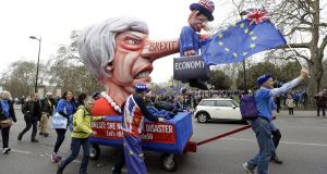 Demonstrators pull a cart with a doll resembling Theresa May during an anti-Brexit march in London on Saturday, Saturday. Photograph: Kirsty Wigglesworth/AP