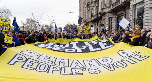 "People unfurl a large banner calling for a ""People's Vote"". Photograph: Niklas Halle'n/AFP/Getty Images"