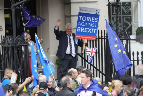 A Boris Johnson impersonator waves to the crowds. Photograph: Aaron Chown/PA Wire
