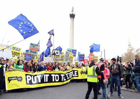 The crowds arrive at Trafalgar Square carrying banners and flags. Photograph: Facundo Arrizabalaga/EPA