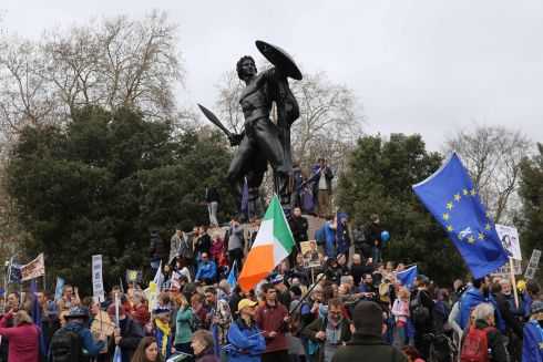 An Irish tricolour and the EU flag can be seen among the crowds around the statue of the Greek hero Achilles in Hyde Park. Photograph: Isabel Infantes/AFP/Getty Images