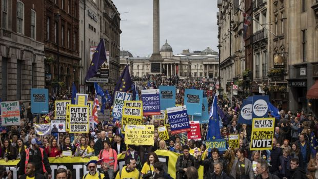 Protesters take part in the Put It To The People march on Whitehall in London, England. Photograph: Dan Kitwood/Getty Images