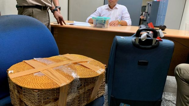 The belongings of Russian national Andrei Zhestkov are seen in a room following his arrest at an airport in Bali, Indonesia. Photograph: BKSDA Bali via AP