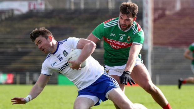 Monaghan's Dessie Mone is challenged by Aidan O'Shea of Mayo during the Allianz Football League Division 1 match at Elverys MacHale Park in Castlebar. Photograph: Bryan Keane/Inpho