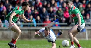 Monaghan's Conor McManus with Chris Barrett and Brendan Harrison of Mayo during the Allianz  Football League Division 1 match at  Elverys MacHale Park in Castlebar. Photograph: Bryan Keane/Inpho