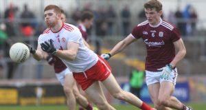 Tyrone's Cathal McShane in action against Galway's John Daly during the Allianz Football League Division 1 match at  Healy Park in Omagh. Photograph: Lorcan Doherty/Inpho