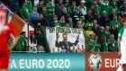 Republic of Ireland fans display a banner critical of former FAI CEO John Delaney at the Republic of Ireland's game against Gibraltar at the Victoria Stadium. Photograph: James Crombie/Inpho