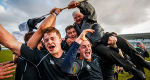 SHOULDER TO SHOULDER: Connemara celebrate with John O'Flaherty after their victory over Creggs in the Connacht Junior Cup final at the Sportsground in Galway. Photograph: Oisin Keniry/Inpho