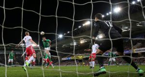 Northern Ireland's Jonny Evans scores against Belarus. Photograph: Reuters