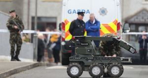 Gardaí and an army bomb disposal robot at the scene of an unexploded bomb in the estate in Drogheda, Co Louth. Photograph:  Niall Carson/PA Wire