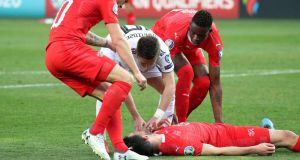 Fabian Schar was allowed to play on against Georgia despite being knocked unconscious. Photograph: Irakli Gedenidze/Reuters