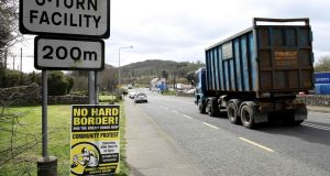 UNCERTAINTY, STILL: A lorry passes a poster located on the Irish border, urging no hard border between the Republic and Northern Ireland, after the situation regarding Brexit is eventually finalised. Photograph: Paul Faith/AFP/Getty