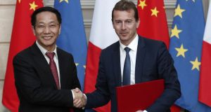 President of Airbus Commercial Aircraft, Guillaume Faury (right), and chairman of China Aviation Supplies Co, Jia Baojun, at an agreement-signing ceremony at the Elysée Palace in Paris. Photograph: Yoan Valat/Pool/Reuters
