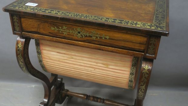 Lot 205: Regency rosewood and brass inlaid work table (€2,400-€2,800).
