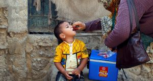 A boy receives polio vaccine drops, during an anti-polio campaign, in a low-income neighbourhood in Karachi, Pakistan April 9, 2018. File photograph: Akhtar Soomro/Reuters