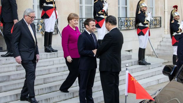 French president Emmanuel Macron welcomes Chinese president Xi Jinping at the Élysée Palace in Paris. Photograph: Christophe Morin/Bloomberg