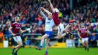 Galway's Darren Morrissey competes with Shane Barrett of Waterford. Photograph: Tommy Dickson/INPHO