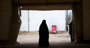 A woman in Al-Hawl camp in northeast Syria. Photograph: Fadel Senna/AFP/Getty Images
