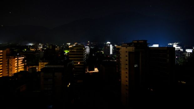 A distract in Caracas without light during a power outage. Photograph: Juan Barreto/AFP/Getty Images