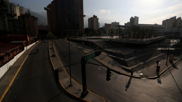 Commercial area during a blackout in Caracas, Venezuela. Photograph: Ivan Alvarado/Reuters