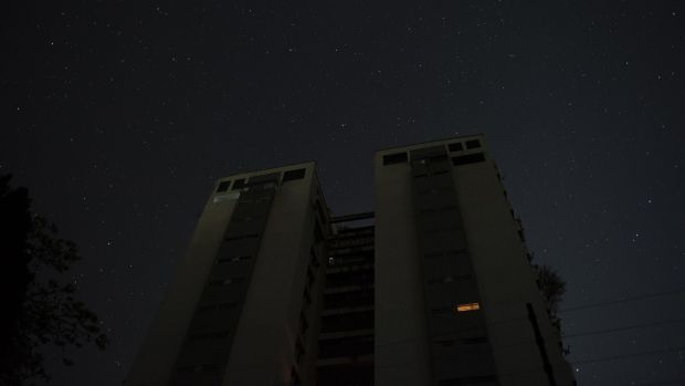 An apartment building stands during a power outage in the Palos Grandes district of Caracas. Photograph: Carlos Becerra/Bloomberg