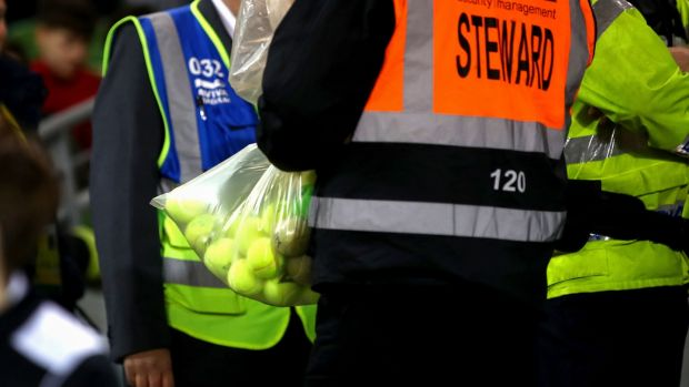 A steward with a bag of confiscated tennis balls at the Aviva Stadium. Photograph: James Crombie/Inpho