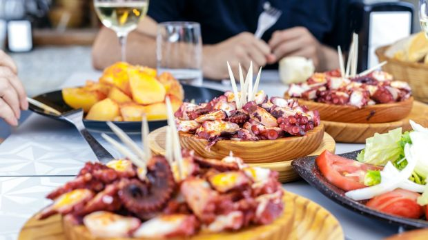 Food is part of almost every social occasion but under no circumstances should you dig in as soon as it lands. Photograph: iStock