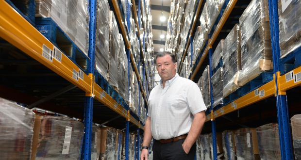 Michael Dixon, of Dixon Transport,  in a   warehouse   full of   goods because of Brexit. Photograph: Dara Mac Dónaill