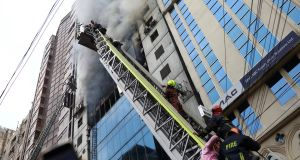 People  being rescued after a fire broke out at a multi-storey commercial building in Dhaka, Bangladesh, on  Thursday. Photograph: Mohammad Ponir Hossain/Reuters