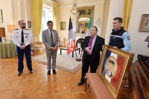 PAY TRIBUTE: Artist Bernard Fallon presents a painting of French gendarme Arnaud Beltrame to Lt Col Étienne Peltier at the French embassy in Dublin. Photograph: Alan Betson/The Irish Times