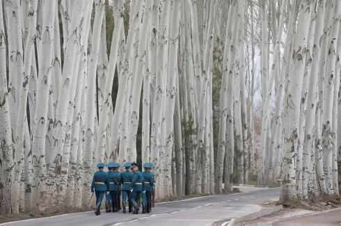 SPECIAL BRANCH: Kyrgyz guards walk away after a welcoming ceremony attended by Russian president Vladimir Putin in Bishkek, Kyrgyzstan. Photograph: Maxim Shemetov/Reuters