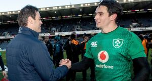 Munster head coach Johann van Graan congratulates Joey Carbery after Ireland's game against Scotland in Murrayfield. Photograph: James Crombie/Inpho