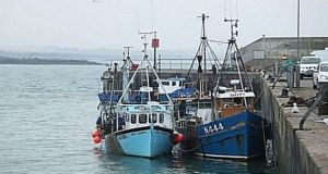 A file image of  two Northern fishing boats seized by the Naval Service for fishing in an exclusion zone off the State's coast. File photograph: Niall Carson/PA
