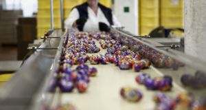 Cadbury Creme Eggs move along the production line at the Bournville Cadbury factory, operated by Mondelez International.