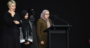 Two girls, whose father was killed at Al Noor mosque, speak during the National Remembrance Service. Photograph: Kai Schwoerer/Getty Images
