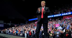 US president Donald Trump arrives to speak at a campaign rally in Grand Rapids, Michigan, on Thursday night. Photograph:  Joshua Roberts/Reuters