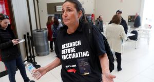 A woman opposed to childhood vaccinations takes part in a demonstration after officials in Rockland County, a New York City suburb, banned children not vaccinated against measles from public spaces. Photograph: Reuters