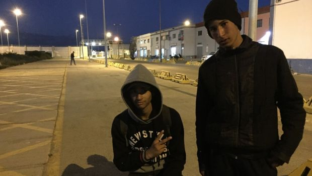 Mohamed (left) and Ayman in Ceuta's port area where each day they attempt to stow away on vehicles heading for the Spanish mainland. Photograph: Guy Hedgecoe