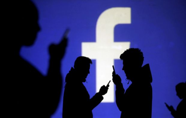 Content moderators: Facebook says it is committed to supporting its workers. Photograph: Dado Ruvic/Reuters