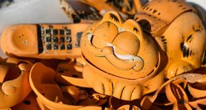 Spare parts of plastic Garfield phones displayed on the beach in Plouarzel, western France, after being collected from a sea cave by environmental activists. Photograph: AFP